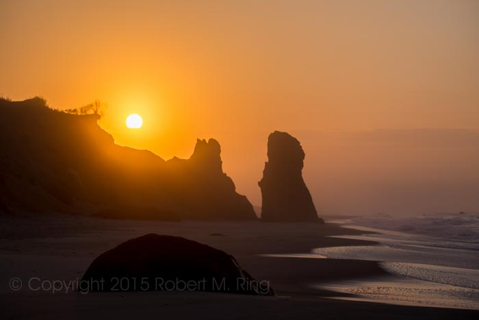 The sun rising up over 'sand sculptures' at Lucy Vincent Beach.
