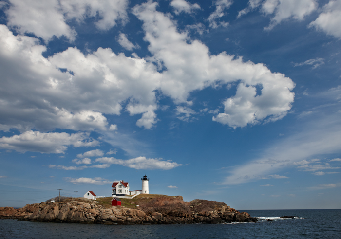 Living in New England this lighthouse is very popular. The clouds were dynamic and the water calm.