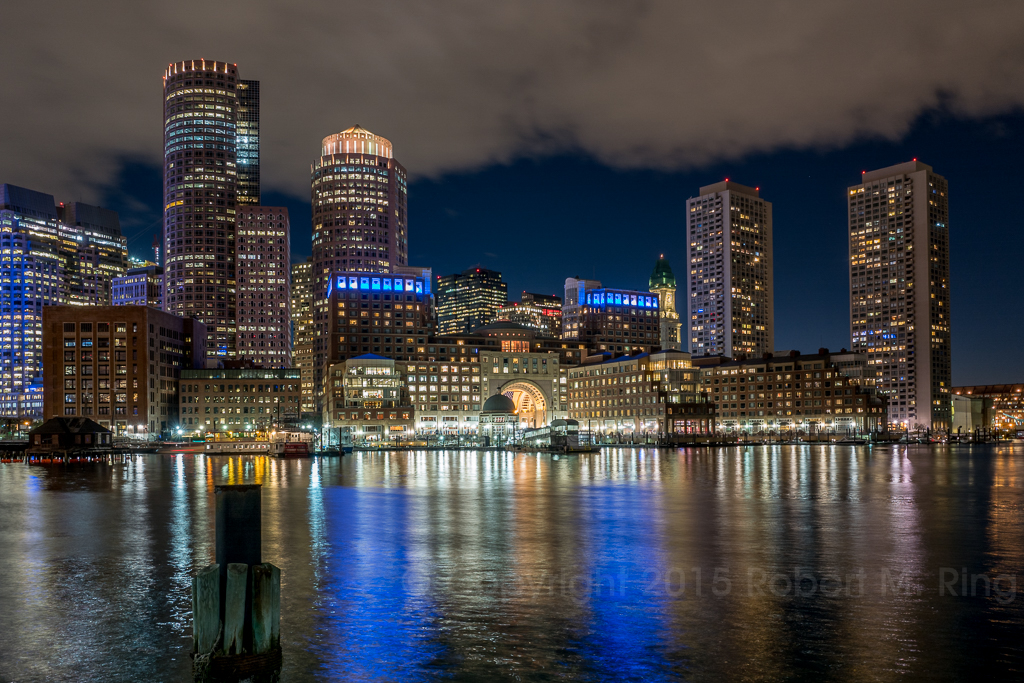 After Sunset In Boston the reflections in the harbor reveal themselves in a colorful way.