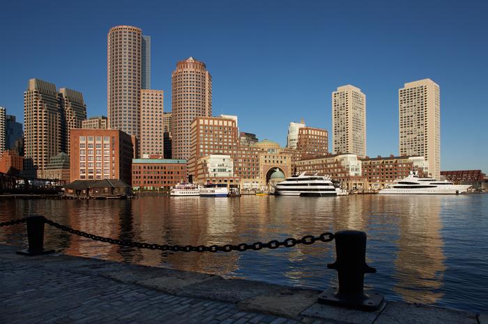 Lookingtowards Rowe's Wharf in Boston on a clear blue sky morning.