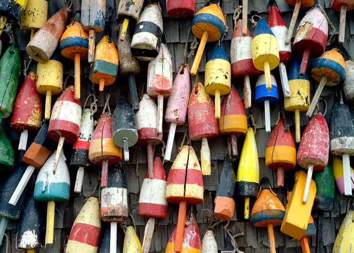 Buoys Hanging on the side of an old shack.