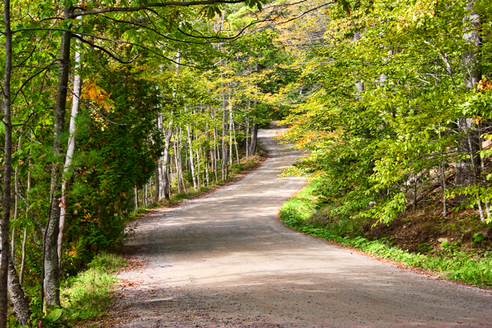 This dirt road heads back into Rockport, Maine.