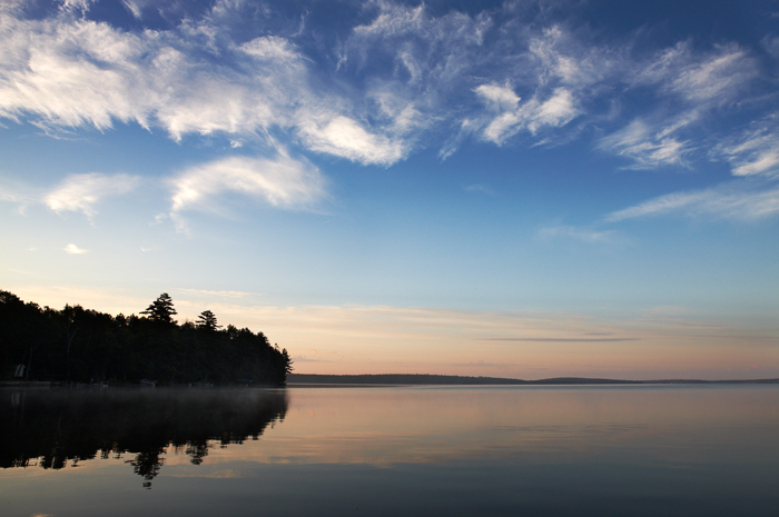 The sun is just about to come up over this lake in the middle of Maine.