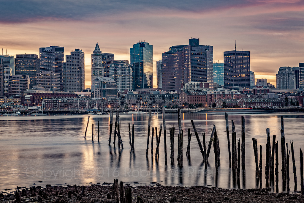BOSTON OLD & NEW...The Boston skyline as seen from East Boston as the sun went down. The old pier in the foreground provides...
