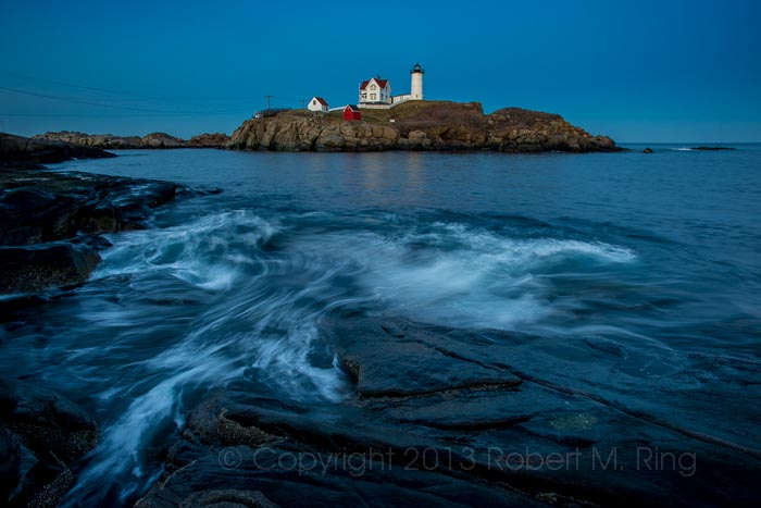 At the end of the day at Nubble Light on the coast of Maine. After the sun goes down the light turns blue!
