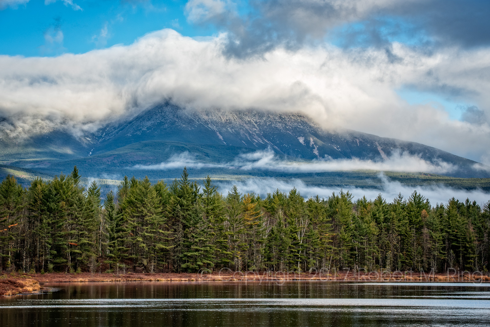 Standing on the shore of this little Sunday Pond looking over to Mount Katahdin in Maine early in the morning may result in some...